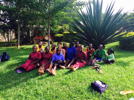 Sponsored school girls sit with SHF founder Robin