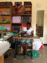 Woman sewing at the new Tailoring Center