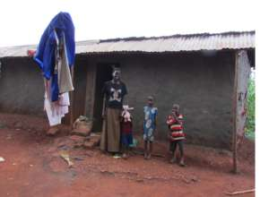 Alum at her home where she lives with six children