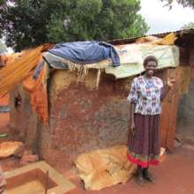 One of our women beaders, Margaret, at her home.