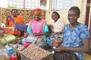 Jinja women inspecting items they made july 2017