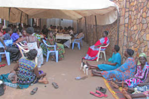 Women's group meeting to discuss project details