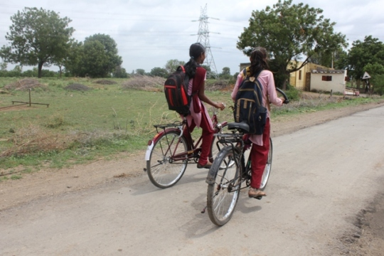 Girls going to school on bicycle
