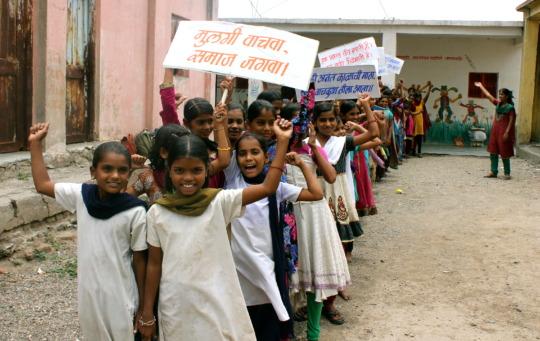 Adolescent girls rally.