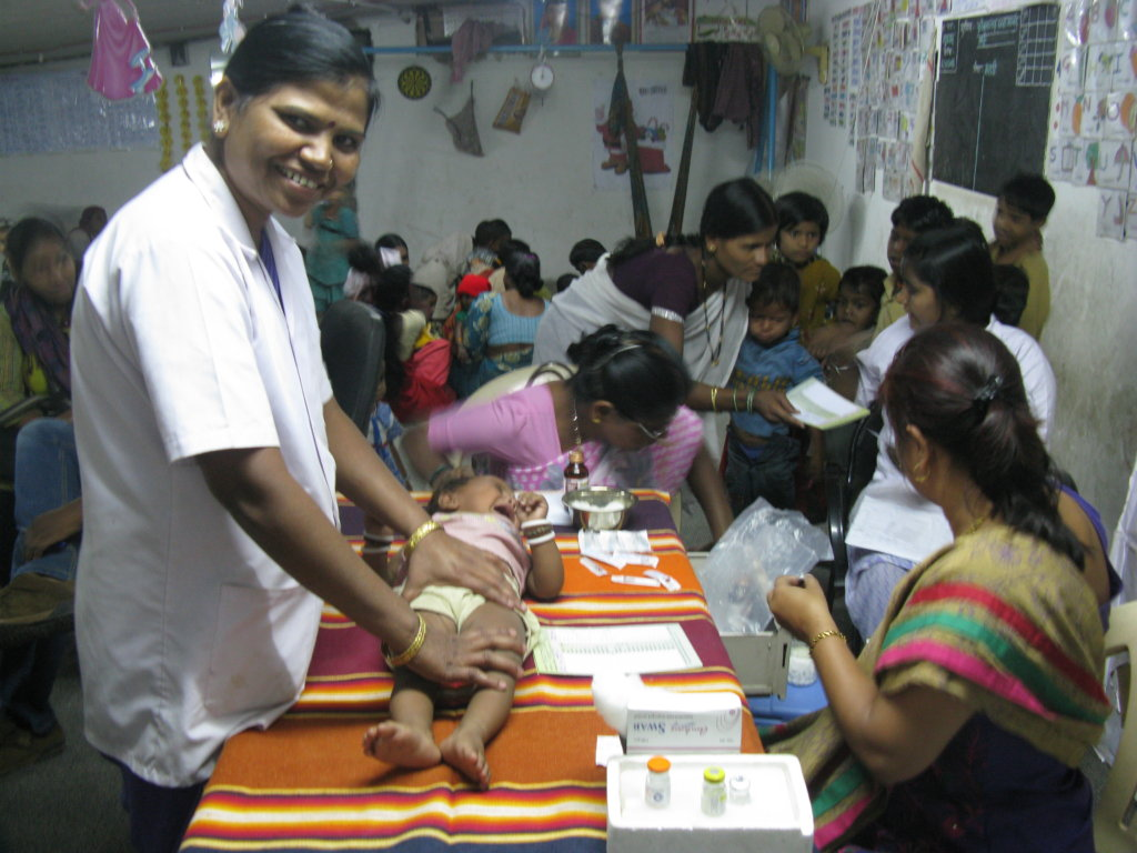 Nirmala assisting a baby