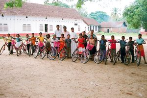 Happy boys and girls at school with their new bikes