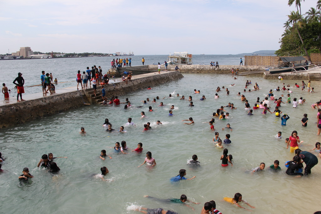 Kids pampering themselves in beach during fun day