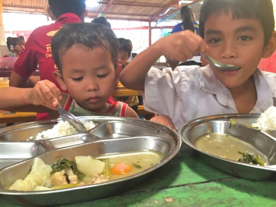 After cleanup, children again enjoying hot lunches
