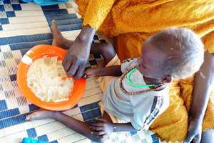 A child receives food.