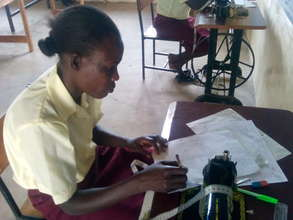one one of our girls in clothing technology class