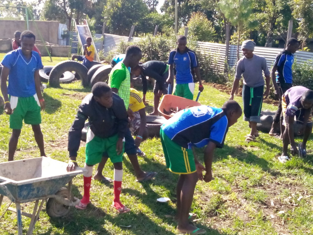 our youth helping at the children home