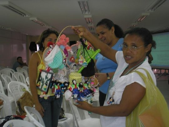One participant shows off her crafts for sale