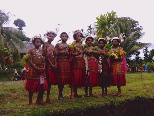 Young girls, Kavailo village in traditional attire