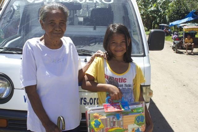 Marivic with her gran Rita and school supplies