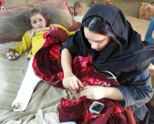 Dr. Zahra Shah of CDRS with a Young Patient