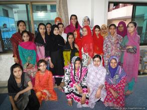 Dr. Chaudhry with Girls at Saba Homes