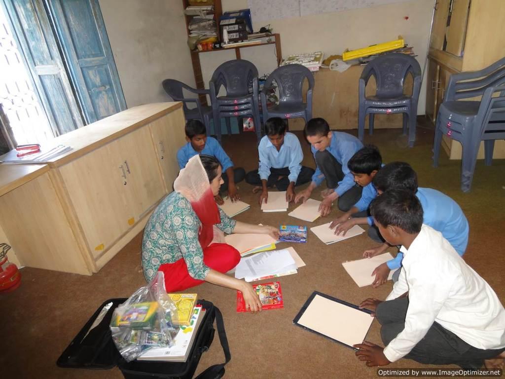 Dr. Rukhsana Chaudhry working with schoolchildren