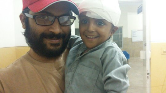 Hamid and Mustafa share a smile after healing