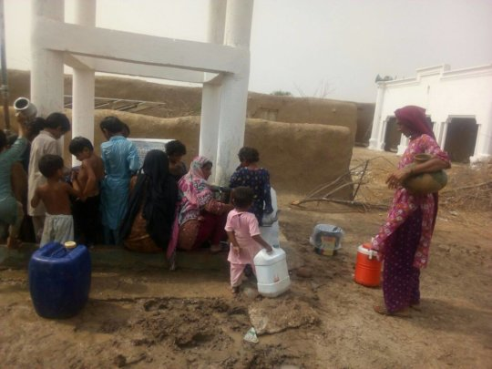 Women and children collecting clean drinking water