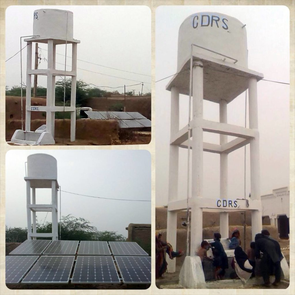 Solar panels and water tank in a town in Punjab