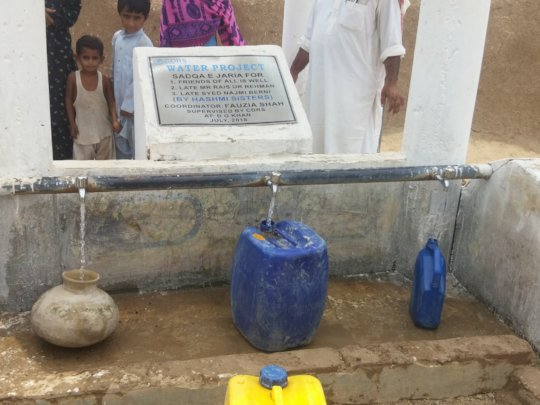Taps fill residents' containers with clean water