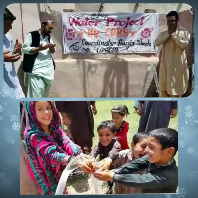 Families and children enjoy their new water pump