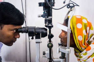 Doctor checking Hamza's eye power: Mayapur centre