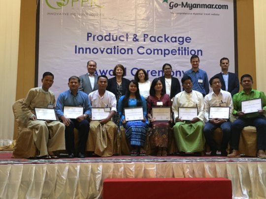 Aye Aung with others at award ceremony in Yangon