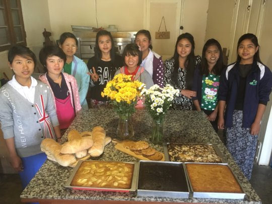 Some of the interns and the new bakery items