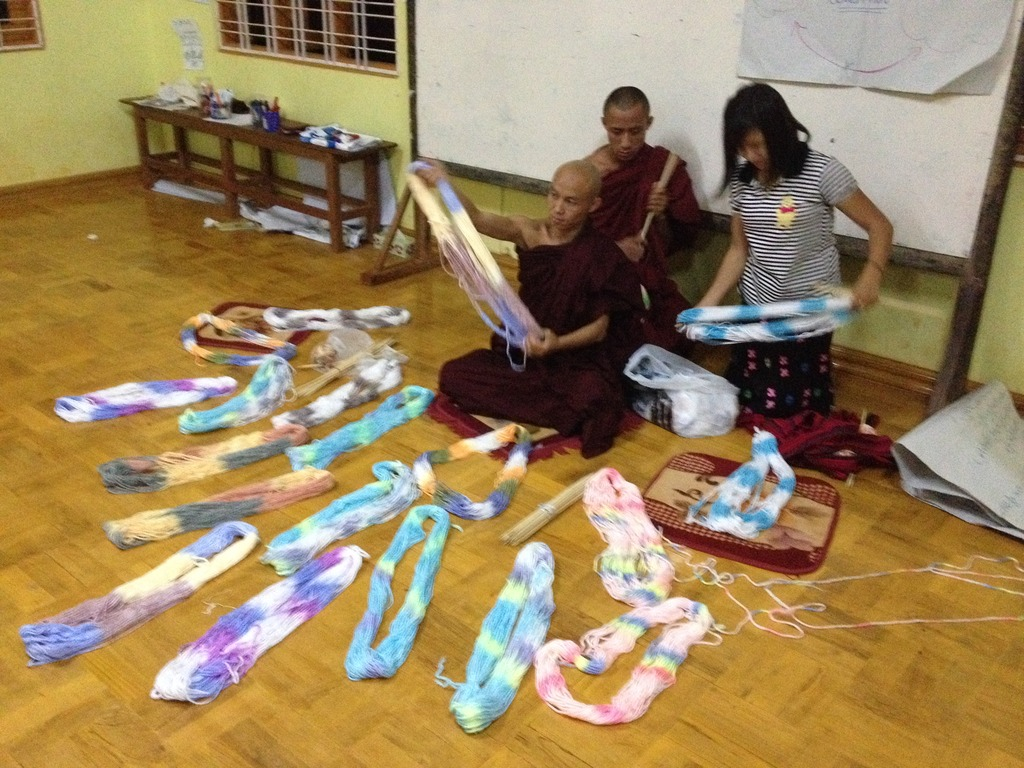 Monks getting yarn ready for knitting workshops