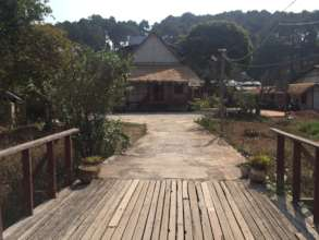 Wooden bridge entrance into new Sprouting Seeds