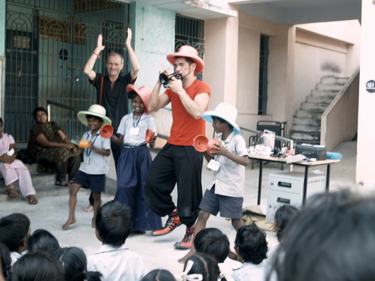 Clown and Magician volunteers performing