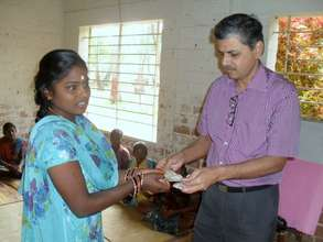 Mr.Bala from Singapore distributes scholarships