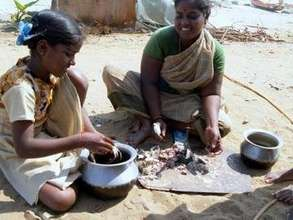 Mother and girl child cleaning the crab for a meal