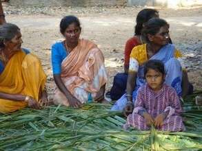 Dalit women learning to make coconut thatch roof