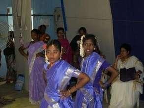 Adolescent girls  dance in International Women's D