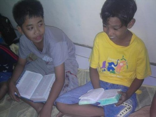 Children doing homework together
