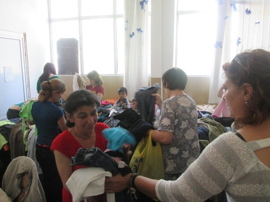 Director Helping to Hand Out Clothing