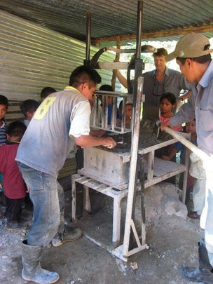 Making Cinder Blocks for houses, latrines, stoves,