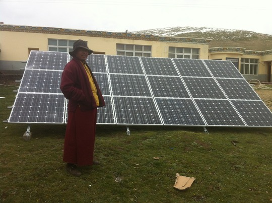 Clinic Administer, Konchog Gelek, with solar array