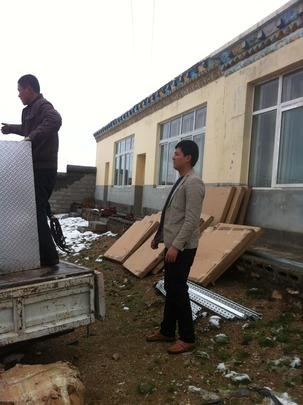 Unloading solar panels at the clinic