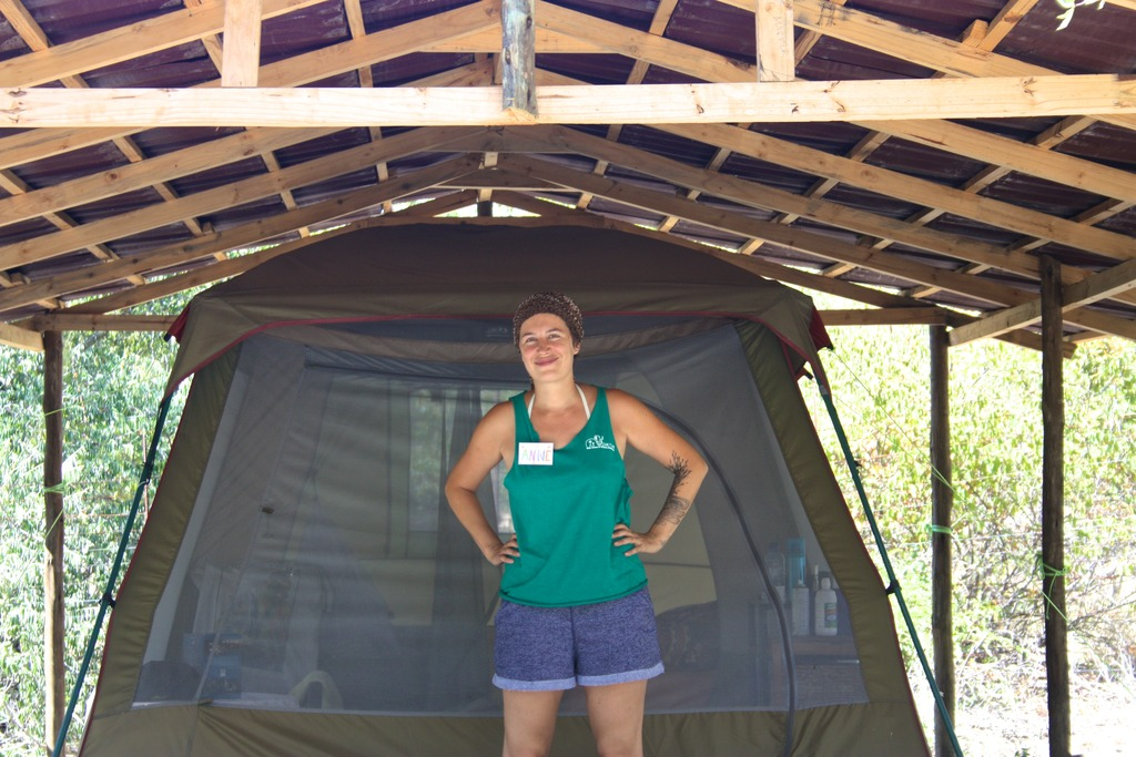 Our volunteer Anne in front of her tent!