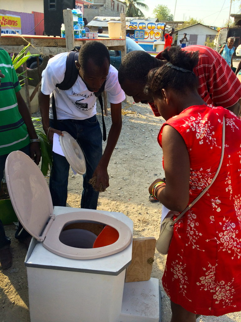 Potential customers inspect a SOIL toilet