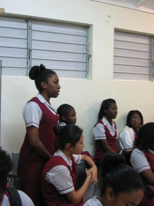 One of the young ladies raises a question