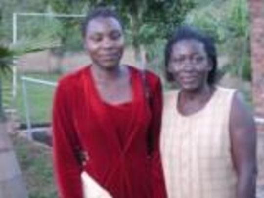 Mercy Atoo welcomed by Mashariki High School Matron (Right)