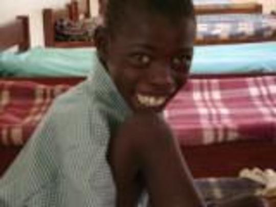 Samsonm Taboswa dressed in his school uniform