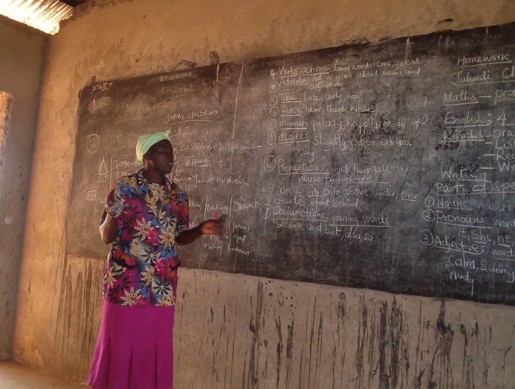 Teacher Claudencia teaching displaced children
