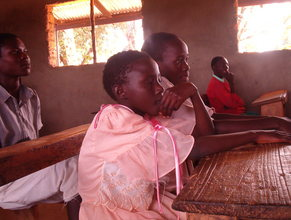 Pupils attentively listening in class
