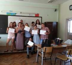 Students with certificates for accomplishments