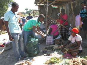 Selling eggplants grown on the SOIL farm